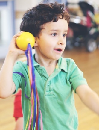 1508 Boy with ribbon ball